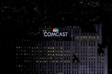 FILE PHOTO -  The NBC and Comcast logo are displayed on top of 30 Rockefeller Plaza, formerly known as the GE building, in midtown Manhattan in New York