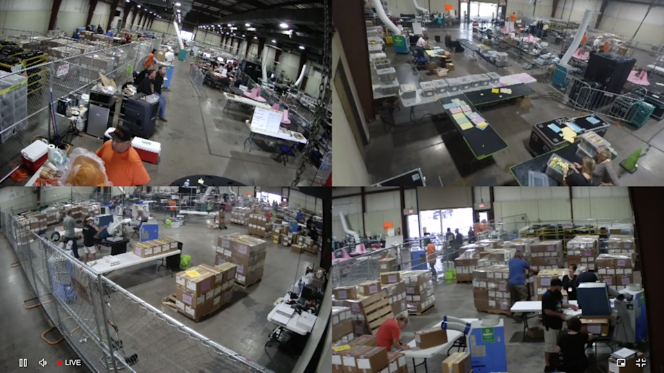 Leaks on the metal roof of a state fairgrounds building caused workers to move and protect ballots during a July 23 thunderstorm as a review of Maricopa County's 2020 election continues. A livestream shows multiple views from inside the building.