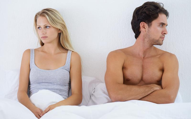 Young couple look unhappy in bed - Digital Vision/PeopleImages