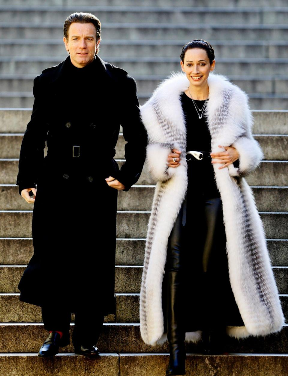 <p>Ewan McGregor and Rebecca Dayan go all-out in outerwear while filming <em>Simply Halston.</em></p>