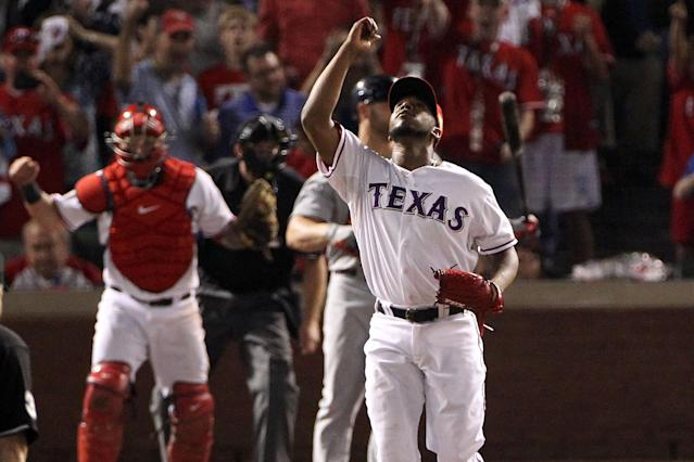 ARLINGTON, TX - OCTOBER 23: Neftali Feliz #30 of the Texas Rangers celebrates after defeating the St. Louis Cardinals 4-0 in Game Four of the MLB World Series at Rangers Ballpark in Arlington on October 23, 2011 in Arlington, Texas. (Photo by Ezra Shaw/Getty Images)
