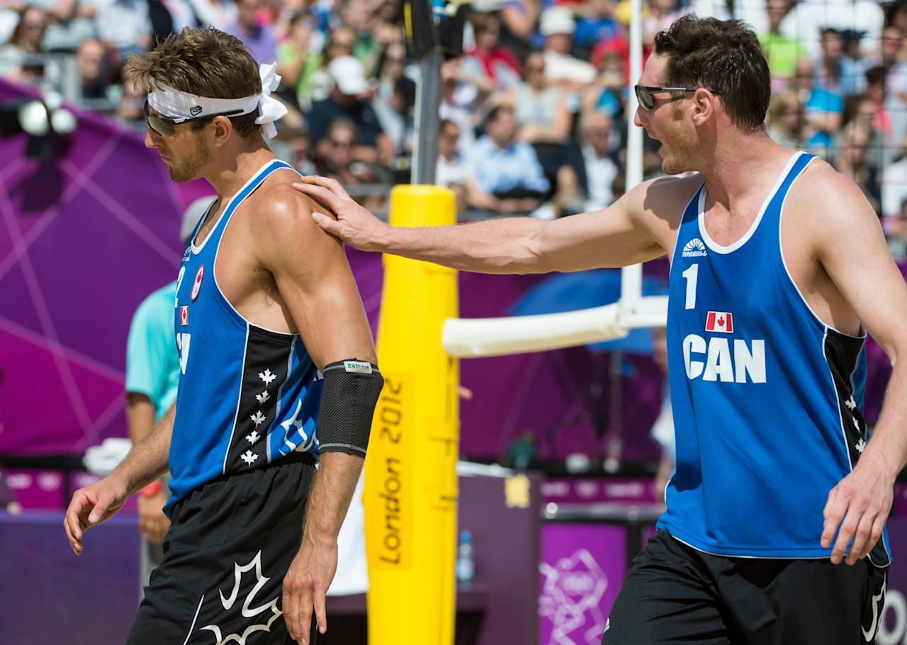 Canada's Joshua Binstock talks to partner Martin Reader during preliminary beach volleyball action against Tarjei Viken Skarlund and Martin Spinnangr at the 2012 London Olympic Games, on July 30, 2012.  Binstock and Reader lost two sets to none. COC Photo: Jason Ransom