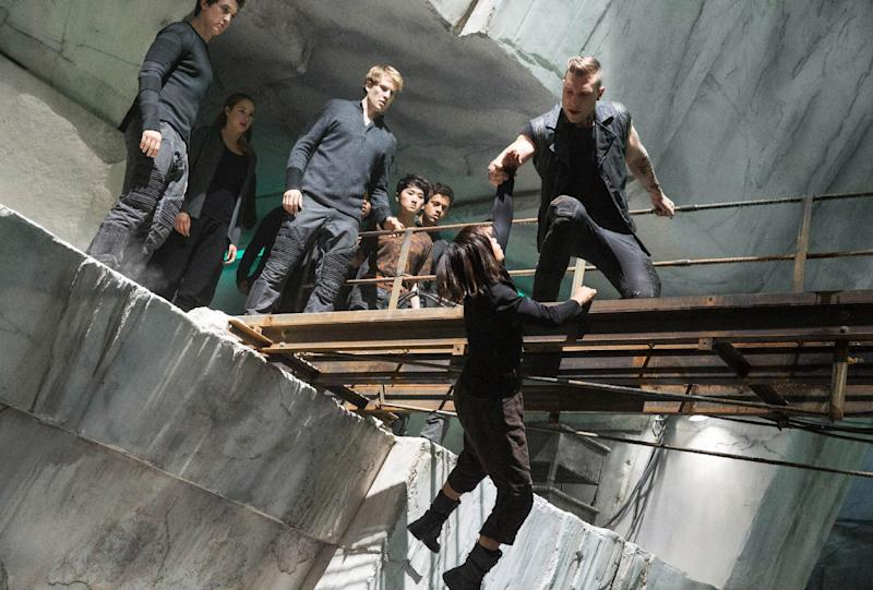 "This photo released by Summit Entertainment shows, from left, Miles Teller, Shailene Woodley, Ben Lamb, Zoe Kravitz, and Jai Courtney, in a scene from the film, ""Divergent."" The film releases on Friday, March 21, 2014. (AP Photo/Summit Entertainment, Jaap Buitendijk)"