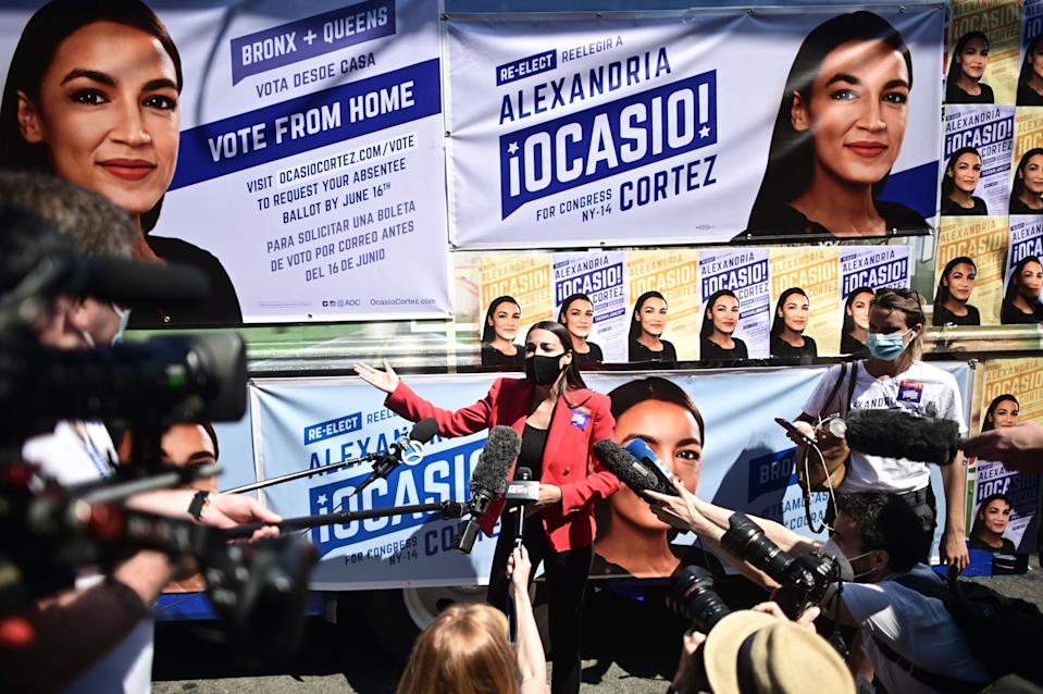 US Representative Alexandria Ocasio-Cortez (D-NY) speaks to the press near a polling station during the New York primaries Election Day on June 23, 2020 in New York City. (Photo by Johannes EISELE / AFP) (Photo by JOHANNES EISELE/AFP via Getty Images)
