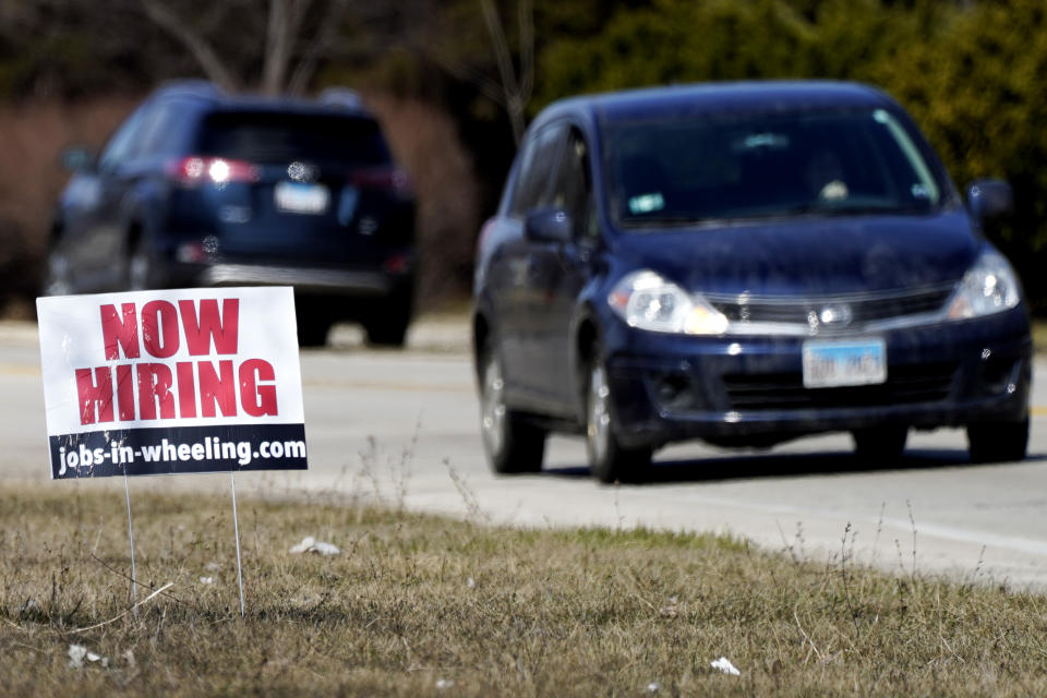 A hiring sign shows in Wheeling, Ill., Sunday, March 21, 2021.  America's employers unleashed a burst of hiring in March, adding 916,000 jobs in a sign that a sustained recovery from the pandemic recession is taking hold as vaccinations accelerate, stimulus checks flow through the economy and businesses increasingly reopen.   (AP Photo/Nam Y. Huh)