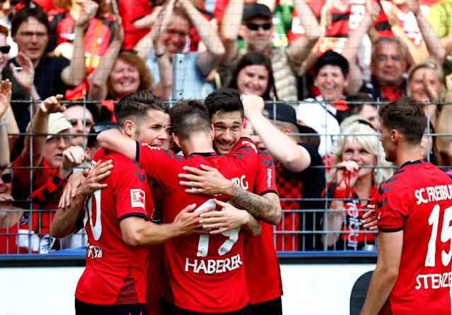 Soccer Football - Bundesliga - SC Freiburg v FC Augsburg - Schwarzwald-Stadion, Freiburg, Germany - May 12, 2018 SC Freiburg's Tim Kleindienst celebrates scoring their second goal with teammates REUTERS/Kai Pfaffenbach DFL RULES TO LIMIT THE ONLINE USAGE DURING MATCH TIME TO 15 PICTURES PER GAME. IMAGE SEQUENCES TO SIMULATE VIDEO IS NOT ALLOWED AT ANY TIME. FOR FURTHER QUERIES PLEASE CONTACT DFL DIRECTLY AT + 49 69 650050