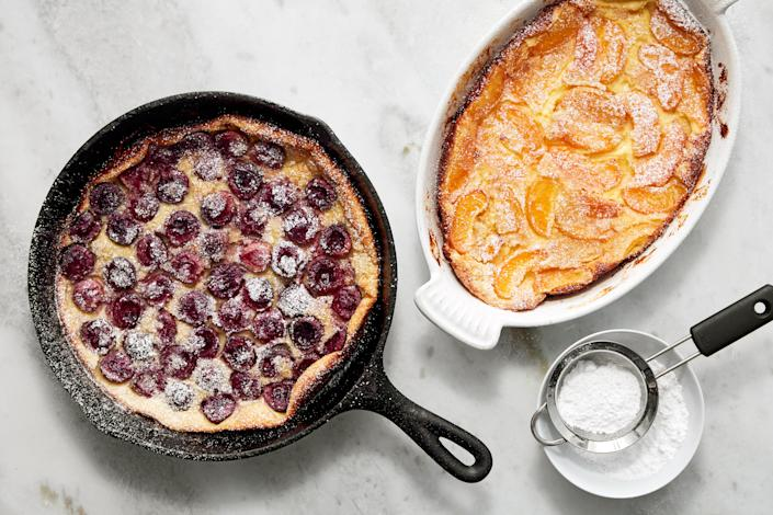"""Choose cherries or apricots or a mix of both for this classic French baked custard. And no special equipment needed means this is the best summer vacation rental house dessert we know. <a href=""""https://www.epicurious.com/recipes/food/views/stone-fruit-clafoutis?mbid=synd_yahoo_rss"""" rel=""""nofollow noopener"""" target=""""_blank"""" data-ylk=""""slk:See recipe."""" class=""""link rapid-noclick-resp"""">See recipe.</a>"""