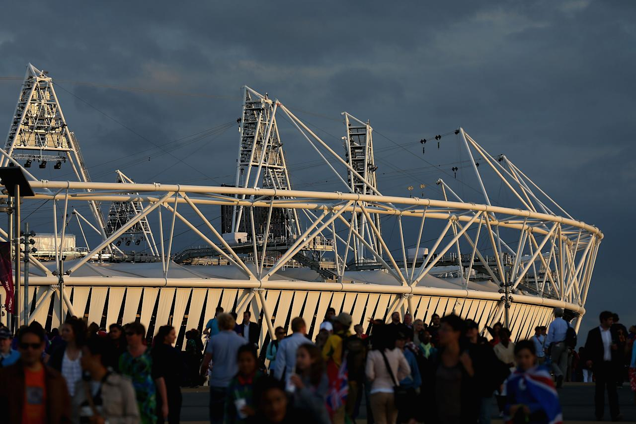 LONDON, ENGLAND - AUGUST 02:  People walk near the Olympic Stadium at Olympic Park on August 2, 2012 in London, England.  (Photo by Cameron Spencer/Getty Images)