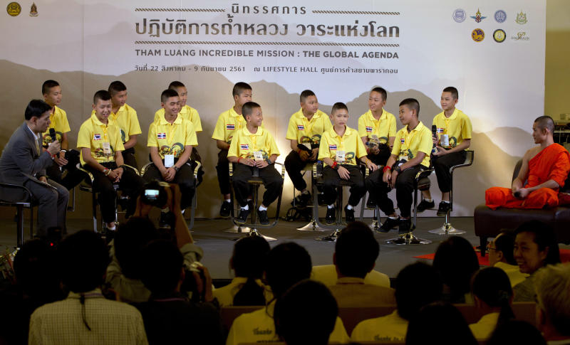 FILE - In this Sept. 6, 2018, file photo, members of the Wild Boars, the soccer team that was rescued from a flooded cave, attend a public discussion in Bangkok, Thailand. The U.S. streaming video giant Netflix has officially announced Tuesday, April 30, 2019, it will join with the production company for the movie Crazy Rich Asians to make a film about last July's dramatic rescue of 12 village boys who were trapped with their soccer coach in a flooded cave in northern Thailand for more than two weeks. (AP Photo/Gemunu Amarasinghe, File)