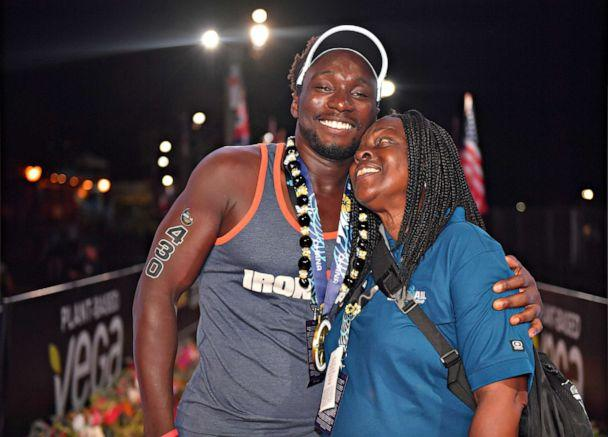 PHOTO:Roderick Sewell with his mother, Marian Jackson, after completing the 2019 Ironman World Championship on Oct. 12, 2019, in Kailua Kona, Hawaii. (Donald Miralle/Getty Images for IRONMAN)