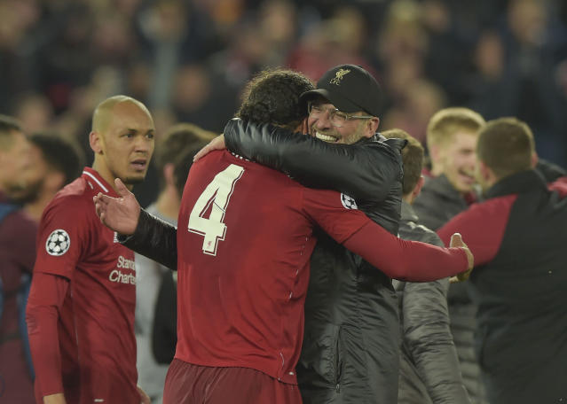 Klopp celebrates with Virgil Van Dijk and Fabinho