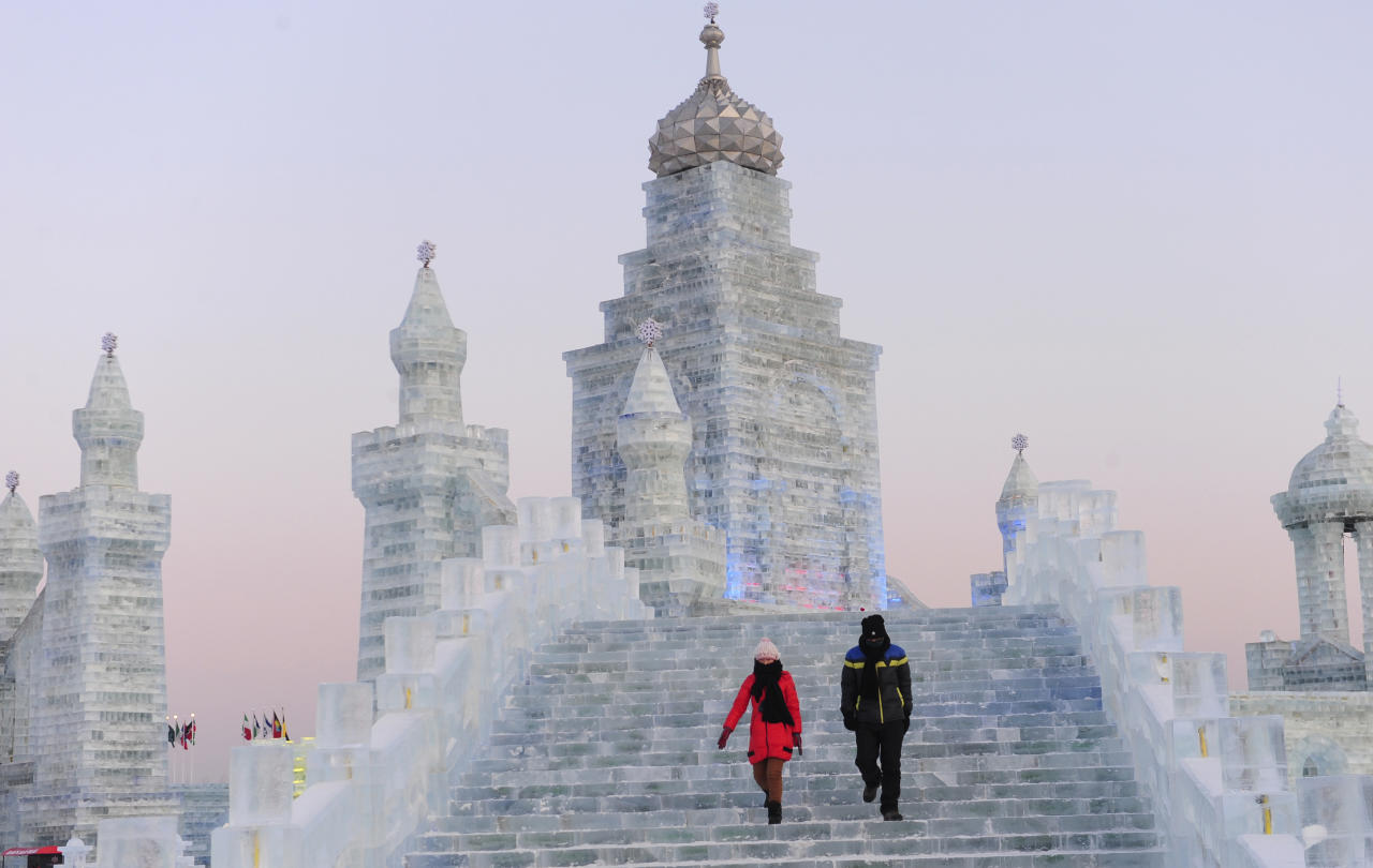 Tourists visit ice sculptures during the testing period of the 13th Harbin Ice and Snow World in Harbin, Heilongjiang province December 25, 2011. The Harbin International Ice and Snow Festival will be officially launched on January 5, 2012. Picture taken December 25, 2011. REUTERS/Sheng Li (CHINA - Tags: ENVIRONMENT ENTERTAINMENT)