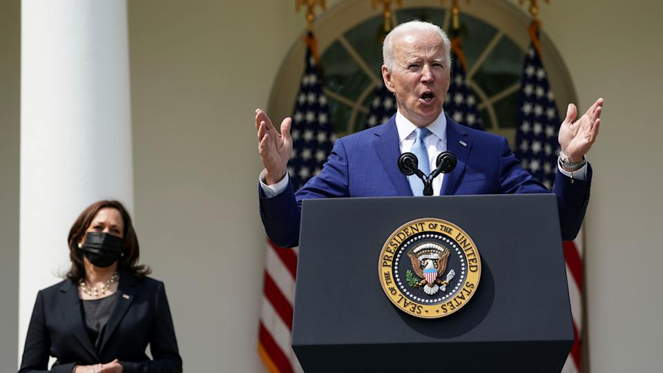 U.S. President Joe Biden is flanked by Vice President Kamala Harris as he announces executive actions on gun violence prevention in the Rose Garden at the White House in Washington, U.S., April 8, 2021. (Kevin Lamarque/Reuters)