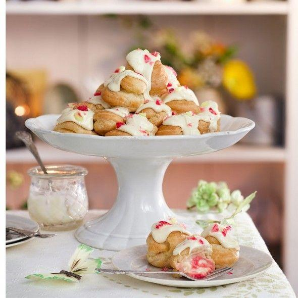 """<p>Use a star nozzle to pipe filling into the buns to prevent the rhubarb clogging the nozzle.</p><p><strong>Recipe: <a href=""""https://www.goodhousekeeping.com/uk/food/recipes/rhubarb-and-custard-profiterole-tower"""" rel=""""nofollow noopener"""" target=""""_blank"""" data-ylk=""""slk:Rhubarb and custard profiteroles"""" class=""""link rapid-noclick-resp"""">Rhubarb and custard profiteroles</a></strong></p>"""
