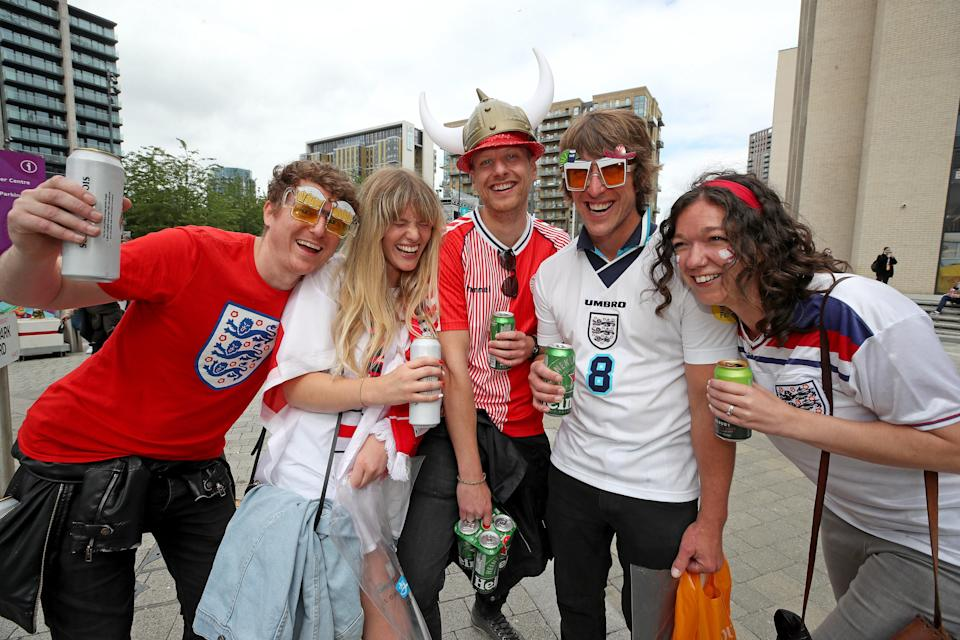 England fans pose with a Danish supporter on Wembley Park Boulevard (PA Wire)