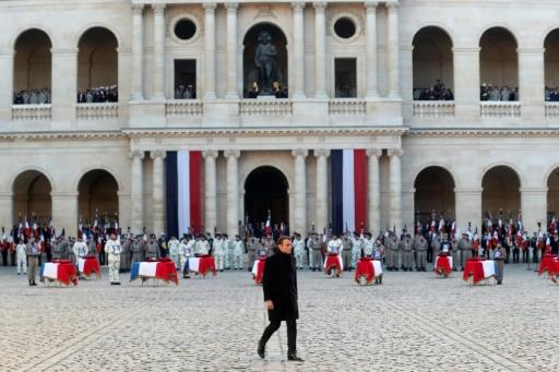 French President Emmanuel Macron said he bowed before the soldiers' 'sacrifice'