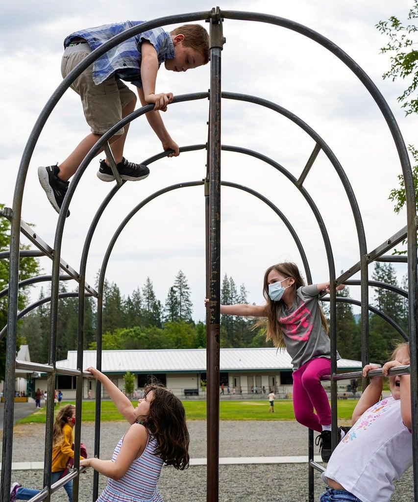 WEAVERVILLE, CA – AUGUST 17: Weaverville Elementary School students play during recess on the first day of returning to in-person instruction for the new school year on Monday, Aug. 17, 2020 in Weaverville, CA. The Trinity Alps Unified School District reopened amid the coronavirus pandemic, resuming in-person classroom instruction. (Kent Nishimura / Los Angeles Times via Getty Images)