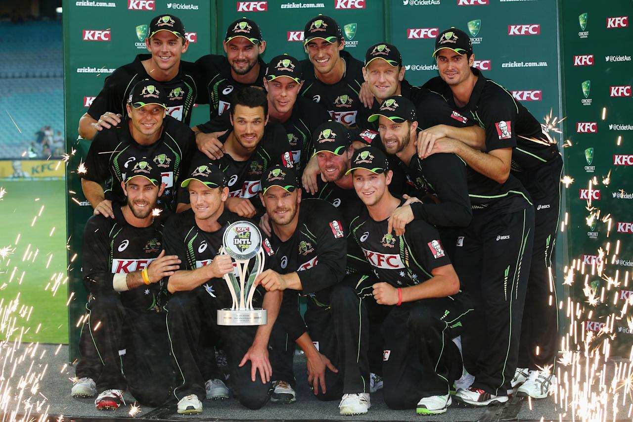 SYDNEY, AUSTRALIA - FEBRUARY 02:  The Australian team pose with the trophy as they celebrate thier series victory after game three of the International Twenty20 series between Australia and England at ANZ Stadium on February 2, 2014 in Sydney, Australia.  (Photo by Mark Kolbe/Getty Images)