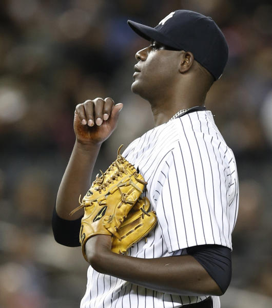 FILE - In this April 10, 2014 file photo, New York Yankees starting pitcher Michael Pineda is shown between pitches during the fourth inning of a baseball game against the Boston Red Sox at Yankee Stadium in New York. After the New York Yankees' right-hander kept Boston's offense in check for six innings Thursday night, postgame talk centered on the dark, seemingly tacky substance that had been on the lower palm of Pineda's pitching hand. (AP Photo/Kathy Willens, File)