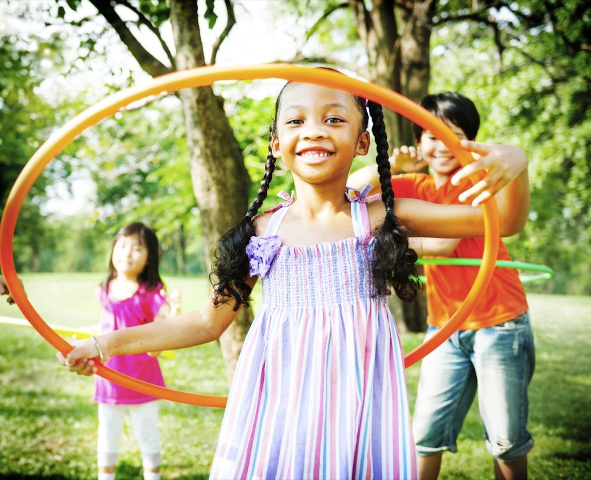 """You might think of a hula hoop as a toy meant for children and Cirque de Soleil performers, but it's a legitimately good fitness tool. According to the <a href=""""https://www.mayoclinic.org/healthy-lifestyle/fitness/expert-answers/weighted-hula-hoops/faq-20058073"""" target=""""_blank"""">Mayo Clinic</a>, hula hooping for 30 minutes burns, on average, 165 calories for women and 200 for men. Best of all: It's a total blast!"""