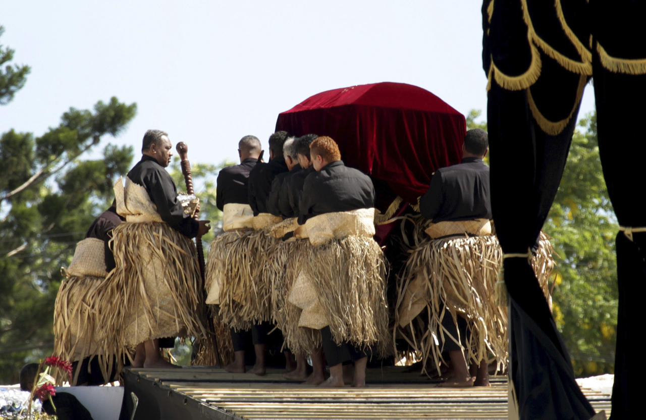 Pall bearers carry the royal casket of Tonga's late King George Tupou V into the Royal Tombs during his funeral in Nuku-alofa, Tonga, Tuesday, March 27, 2012. (AP Photo/New Zealand Herald, Sarah Ivey)