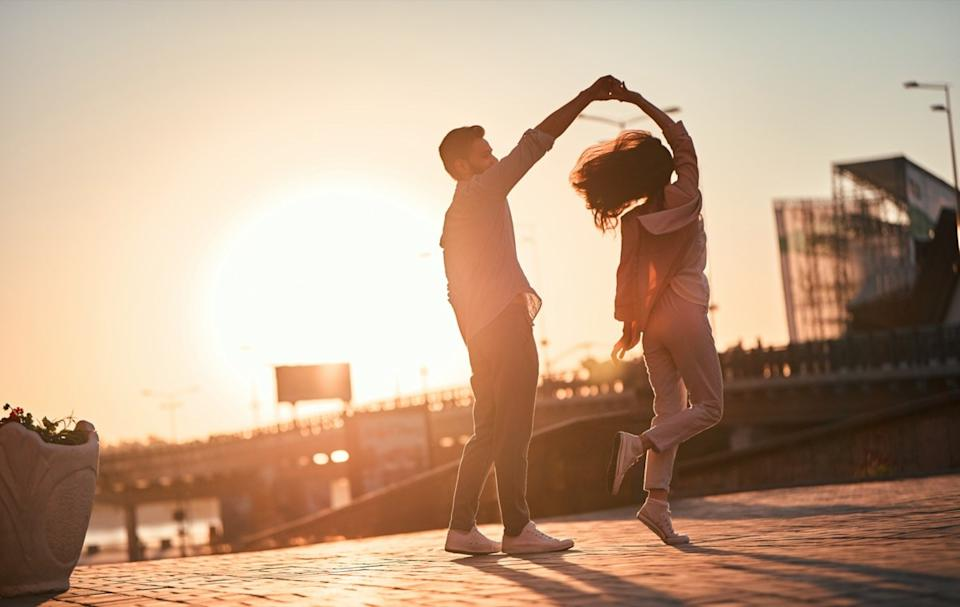 Love is in the air! Cute romantic couple spending time together in the city