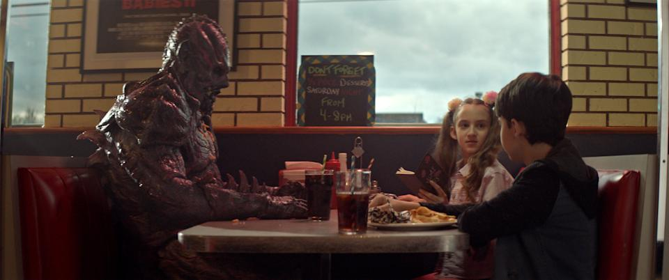 """A malevolent alien overlord (Matthew Ninaber, left) makes friends with a couple of kids (Nita-Josee Hanna and Owen Myre) in the sci-fi horror comedy """"PG: Psycho Goreman."""""""