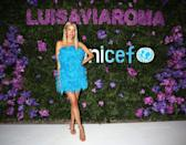 <p><strong>29 August</strong> Leonie Hanne brought a splash of colour in her blue feathered dress.</p>