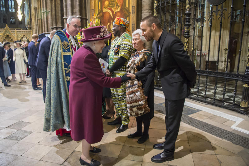 Queen Elizabeth II meets Liam Payne on March 12 at Westminster Abbey.  (WPA Pool via Getty Images)