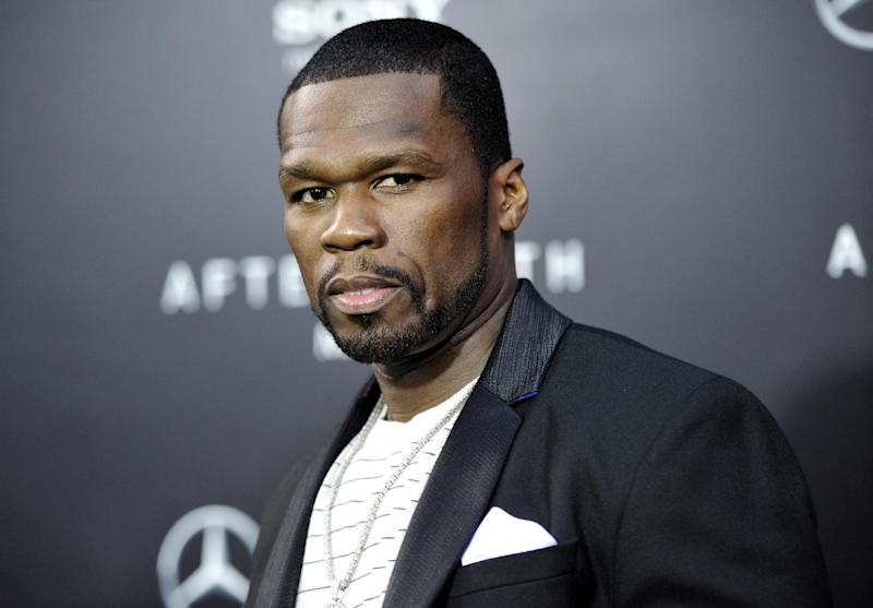 """FILE - This May 29, 2013, file photo, shows rapper Curtis """"50 Cent"""" Jackson at the Ziegfeld Theatre in New York. Rapper and actor 50-Cent is scheduled to face arraignment Monday, Aug. 5, 2013, on charges that he attacked his ex-girlfriend and trashed her condo. (Photo by Evan Agostini/Invision/AP, File)"""