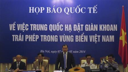 Binh speaks at a news conference on the deployment of a Chinese oil rig in a part of the disputed South China Sea, in Hanoi