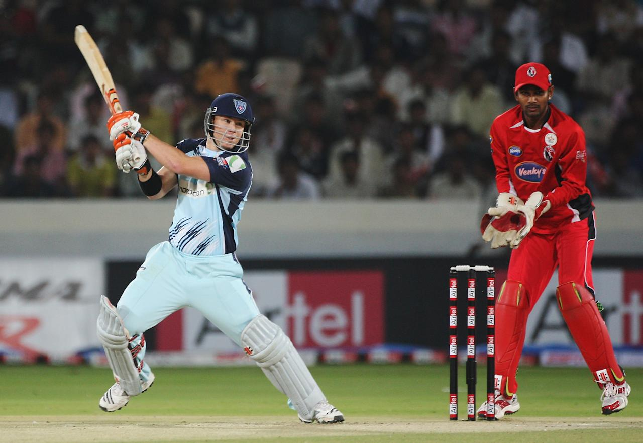 HYDERABAD, INDIA - OCTOBER 23: David Warner of the Blues hits four runs during the Airtel Champions League Twenty20 Final between the NSW Blues v Trinidad & Tobago at the Rajiv Gandhi International Stadium on October 23, 2009 in Hyderabad, India.  (Photo by Daniel Berehulak - GCV/GCV via Getty Images)