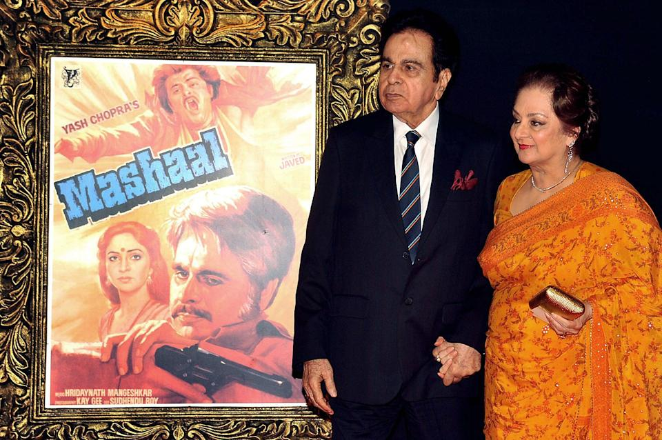 Indian Bollywood film actor Dilip Kumar (L) and his wife Saira Banu pose on the red carpet at a film premiere in 2012 (AFP via Getty Images)