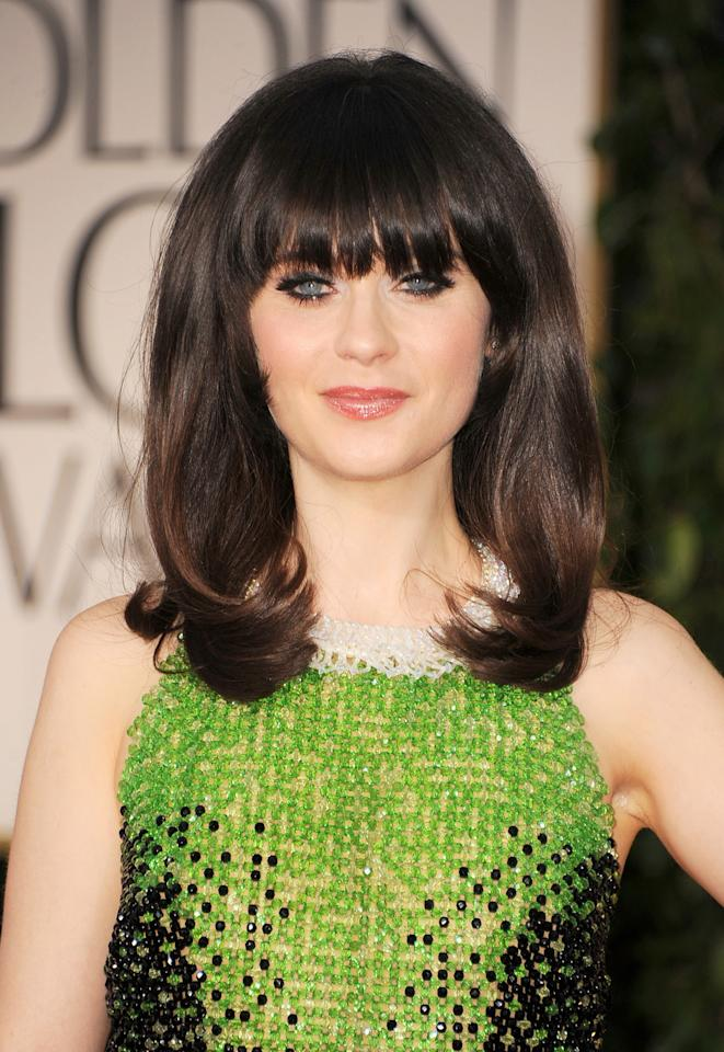 Actress Zooey Deschanel arrives at the 69th Annual Golden Globe Awards held at the Beverly Hilton Hotel on January 15, 2012 in Beverly Hills, California.  (Photo by Frazer Harrison/Getty Images)