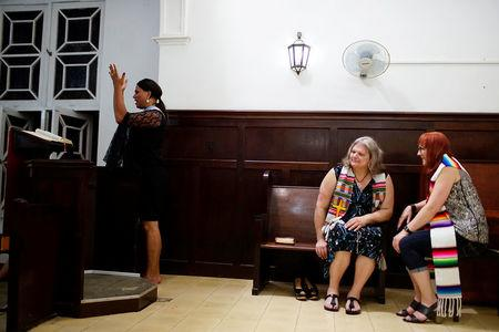 Trans pastor Cindy Bourgeois from Canada (C) and trans Baptist reverend Allyson Robinson from the U.S. (R) listen to trans pastor Alexya Salvador from Brazil during a mass in Matanzas, Cuba, May 5, 2017. Picture taken on May 5, 2017. REUTERS/Alexandre Meneghini