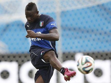 Italy's Balotelli attends a training session at the Dunas Arena soccer stadium in Natal