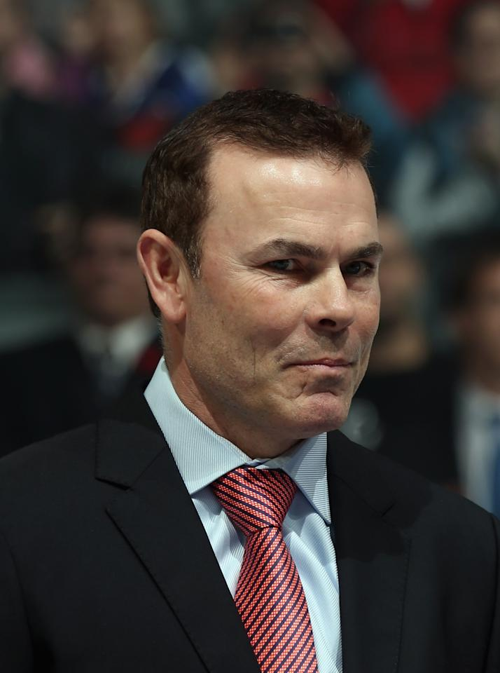 TORONTO, ON - NOVEMBER 11: Adam Oates is presented with his Hall of Fame jacket prior to the Hockey Hall of Fame Legends Game at the Air Canada Centre on November 11, 2012 in Toronto, Canada. Oates will be inducted into the Hockey Hall of Fame at a ceremony at the Hall on November 12.  (Photo by Bruce Bennett/Getty Images)