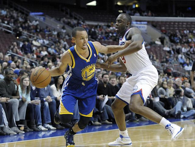 Golden State Warriors' Stephen Curry (30) drives past Philadelphia 76ers' James Anderson (9) during the first half of an NBA basketball game on Monday, Nov. 4, 2013, in Philadelphia. The Warriors won 110-90. (AP Photo/Michael Perez)
