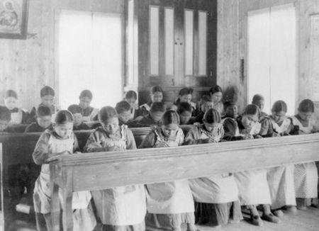 Students sit in a classroom at St Joseph's Convent, otherwise known as the Fort Resolution Indian Residential School in Fort Resolution, Northwest Territories in an undated archive photo. REUTERS/Library and Archives Canada/PA-042133/handout via Reuters