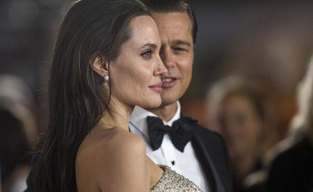 """FILE PHOTO: Director and cast member Jolie and her husband and co-star Pitt pose at the premiere of """"By the Sea"""" during the opening night of AFI FEST 2015 in Hollywood"""