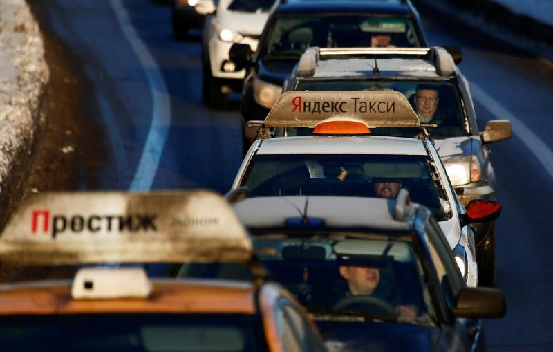 FILE PHOTO: A car with the logo of Russian online taxi service Yandex Taxi is seen stuck in a traffic jam in Moscow