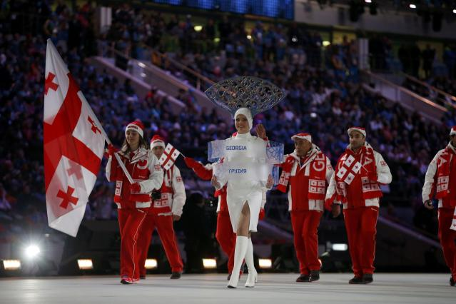 Georgia's flag-bearer Nino Tsiklauri leads her country's contingent during the opening ceremony of the 2014 Sochi Winter Olympics, February 7, 2014. REUTERS/Jim Young (RUSSIA - Tags: OLYMPICS SPORT)