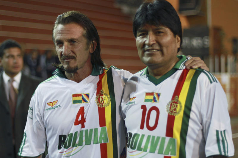 Bolivia's President Evo Morales, right, and U.S. actor Sean Penn pose for photographs before participating in a friendly soccer match in La Paz, Bolivia, Tuesday, Oct. 30, 2012. (AP Photo/Juan Karita)