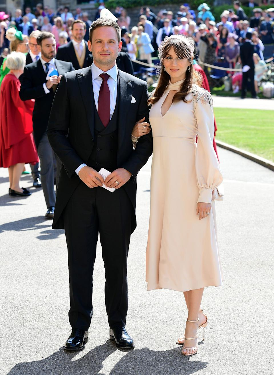 Patrick J. Adams and Troian Bellisario arrive at St George's Chapel at Windsor Castle before the wedding of Prince Harry to Meghan Markle. (Photo: Photo by Ian West - WPA Pool/Getty Images)