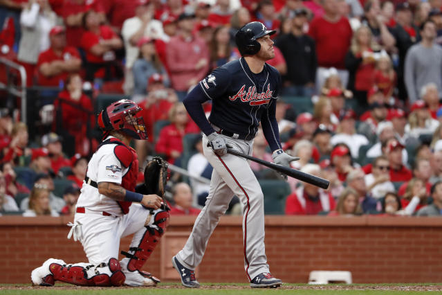 Atlanta Braves' Freddie Freeman flies out as St. Louis Cardinals catcher Yadier Molina, left, watches, ending the top of the eighth inning in Game 3 of a baseball National League Division Series on Sunday, Oct. 6, 2019, in St. Louis. (AP Photo/Jeff Roberson)
