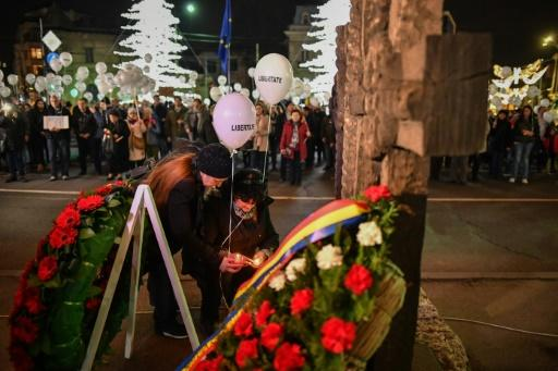 People in Bucharest light candles during the commemoration of the victims of the 1989 Revolution that overthrew Romania's communist dictator Nicolae Ceausescu
