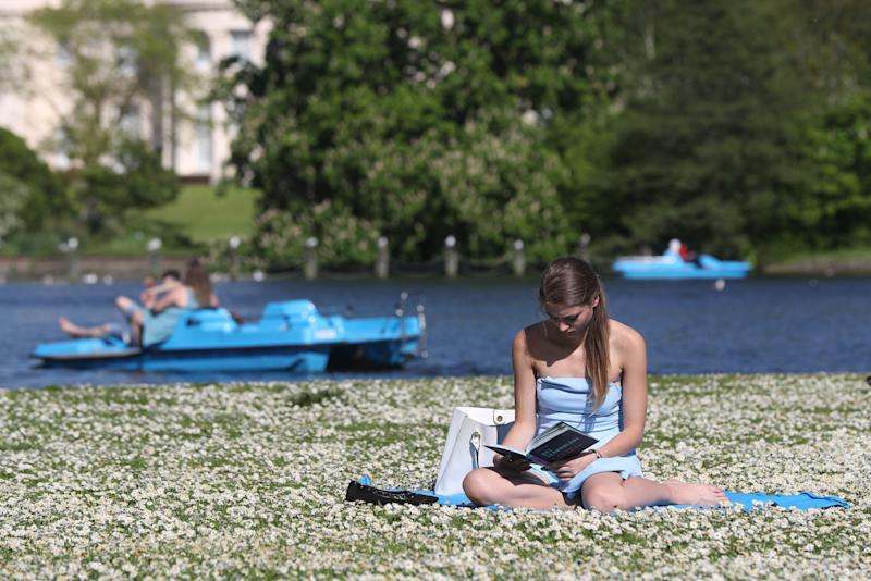 People enjoy the sun in Regent's Park London, as sun worshippers are set to sizzle in the spring heatwave, with Bank Holiday Monday forecast to be the hottest since records began.