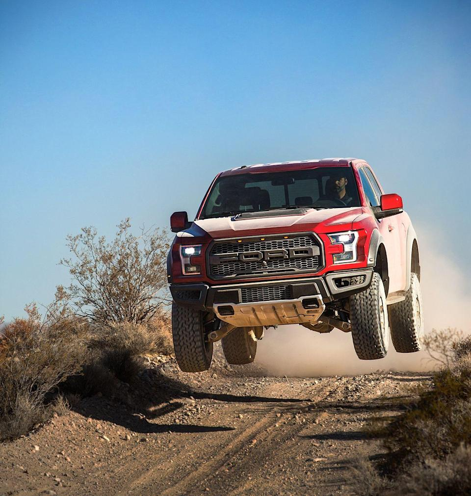 "<p>The <a href=""https://www.caranddriver.com/ford/f-150-raptor"" rel=""nofollow noopener"" target=""_blank"" data-ylk=""slk:Ford Raptor"" class=""link rapid-noclick-resp"">Ford Raptor</a> is more than an amazingly capable off-road truck. It's a cultural icon, a prestige product, and a total badass. It's not built to squeeze through trails, but it gobbles up open desert at high speed and even jumps sand dunes. There are jumping limits, however. See YouTube. It is a Baja racer in spirit, with an aggressive wide-body appearance, a 450-hp twin-turbo V-6, and a long-travel suspension. With a terrain-management system and fancy Fox internal-bypass dampers, the Raptor is ready for a variety of flight patterns, while its standard 34-inch BFGoodrich All-Terrain T/A KO2 tires are available with beadlock wheels. A rear electronic-locking differential with 4.10 gears is standard, and a Torsen limited-slip front differential with 4.10 gears is optional. The Raptor is radical.</p>"
