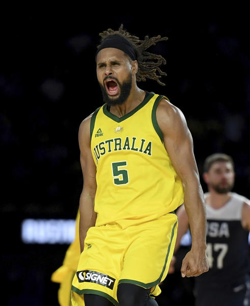 Australia's Patty Mills celebrates after shooting a 3-pointer during their exhibition basketball game against the U.S in Melbourne, Saturday, Aug. 24, 2019. (AP Photo/Andy Brownbill)