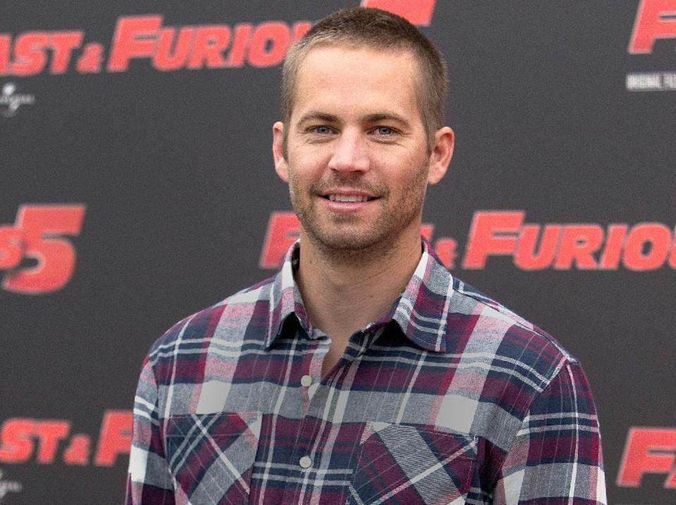 """FILE - In this April 29, 2011 file photo, actor Paul Walker poses during the photo call of the movie """"Fast and Furious 5,"""" in Rome. Crash investigators have determined that the Porsche was traveling approximately 90 mph when it lost control on a city street and smashed into a light pole, killing the actor and his friend Roger Rodas. A person who has reviewed the investigators' report told The Associated Press that it concluded unsafe driving, not mechanical problems, caused the crash. The person requested anonymity because the report has not been officially released yet.AP Photo/Andrew Medichini, File)"""